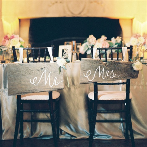 http://www.theknot.com/weddings/photo/mr-and-mrs-reception-chair-signs-125495