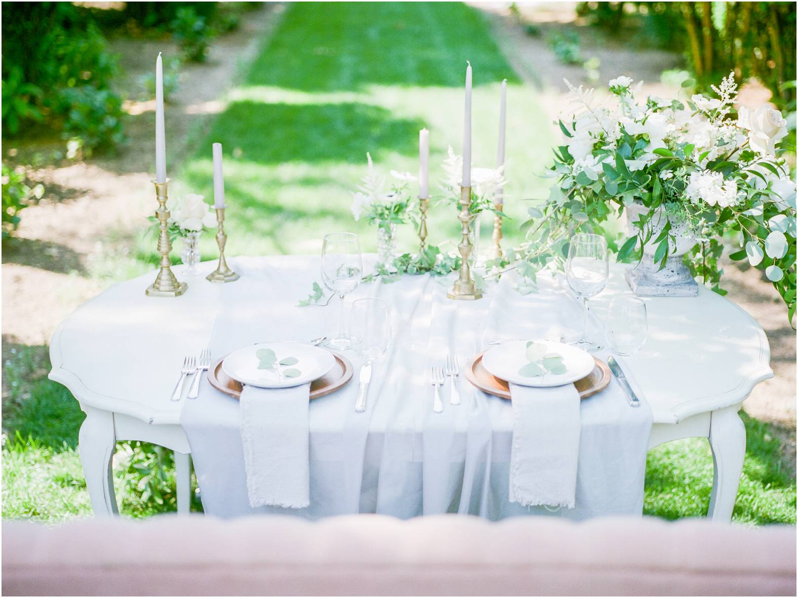 intimate garden wedding table scape of fresh linens and mixed vessles