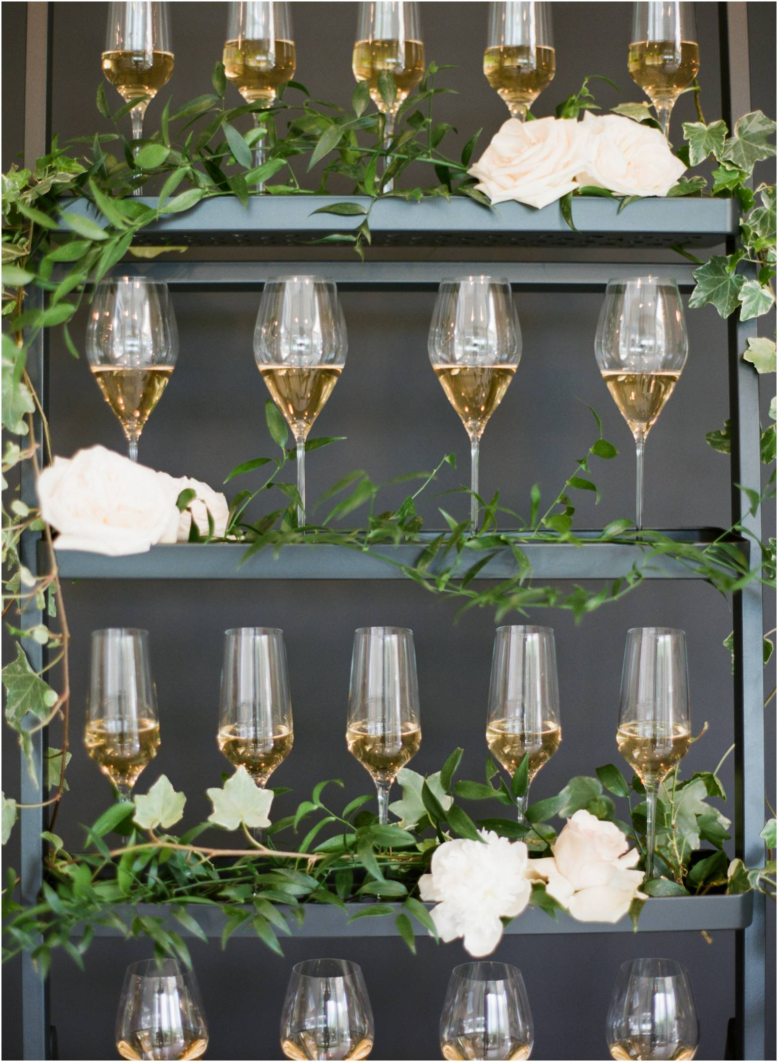 Custom champagne ladders hold welcome drinks for an elevated luxurious cocktail reception at The Gate House in Niagara on the Lake
