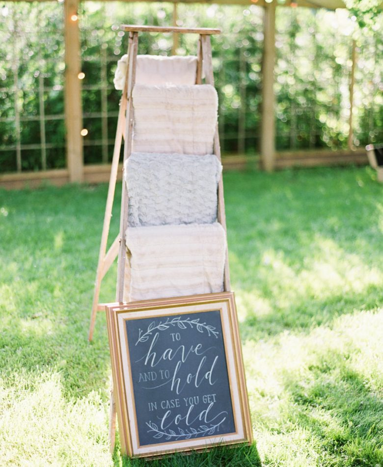 Backyard party with a cozy blanket ladder