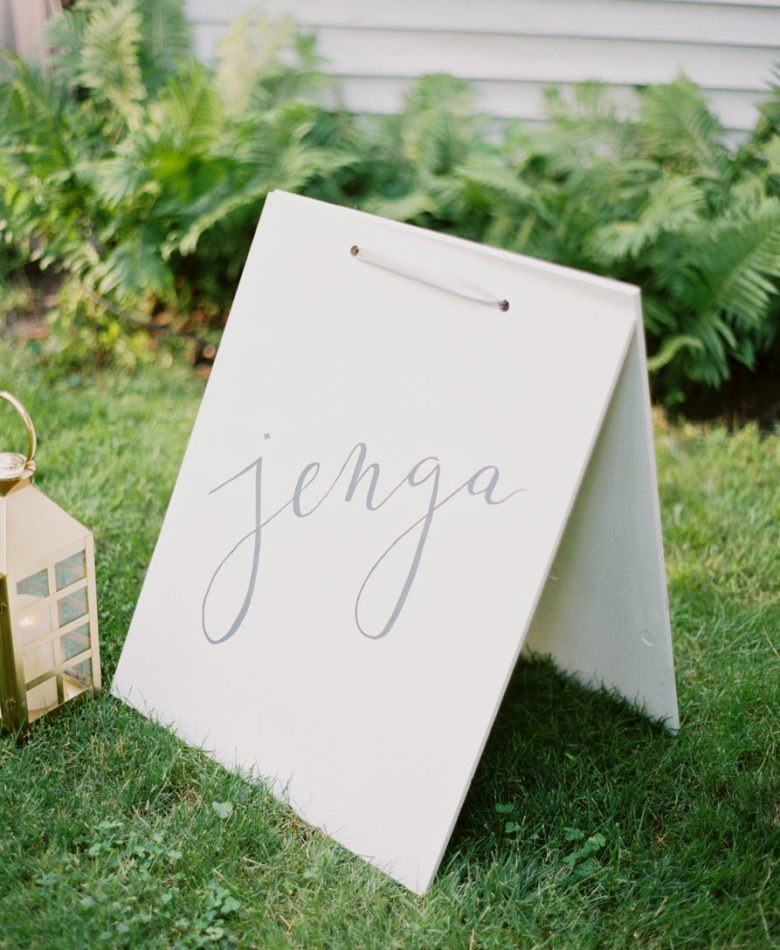 Backyard party with stationery and signage