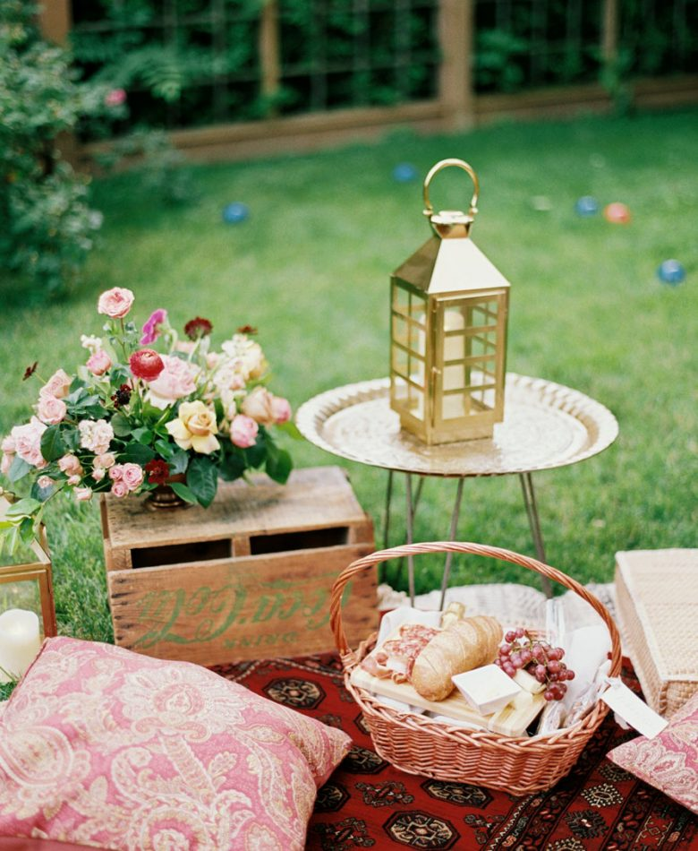 Backyard party with vintage crates and gold lanterns