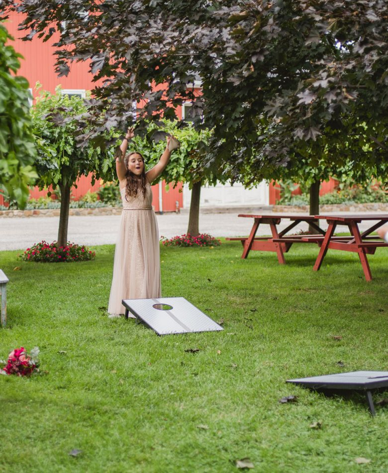 Guests at a wedding playing lawn games