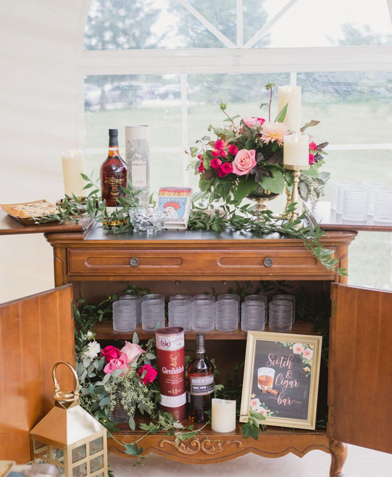An antique cabinet used as a scotch bar for a wedding