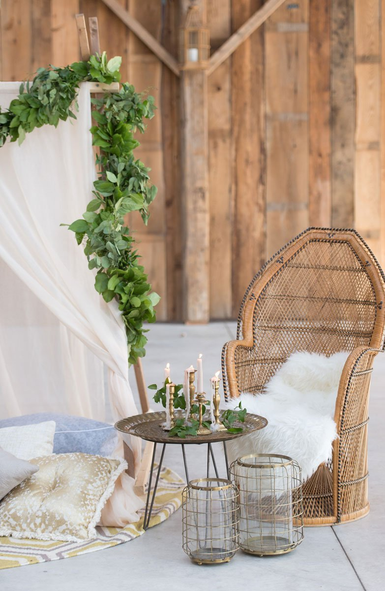 A boho wedding with a wicker peacock chair