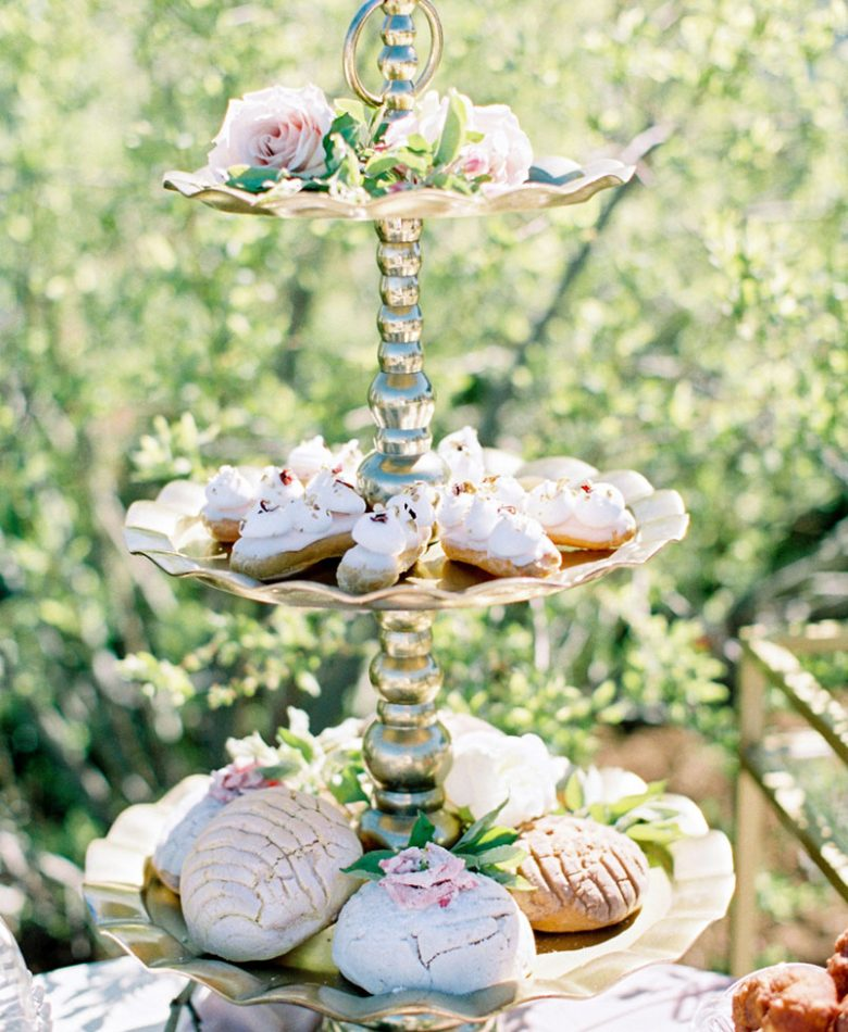 Intimate brunch wedding with a sweets table outdoors and blush decor accents.