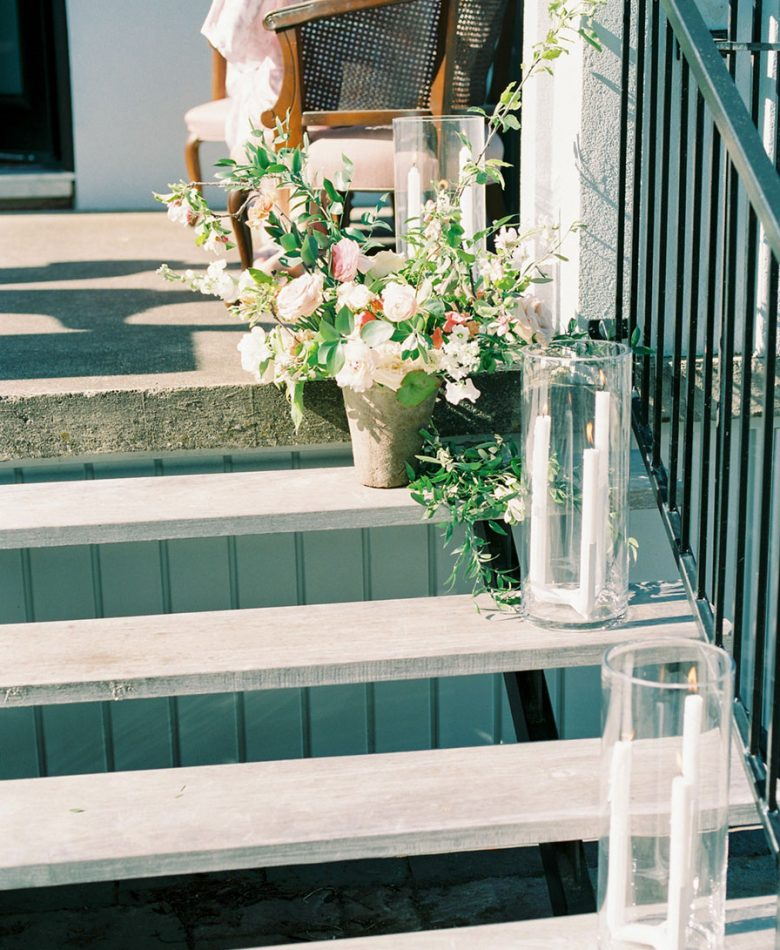 Intimate brunch wedding with hurricane candles on steps