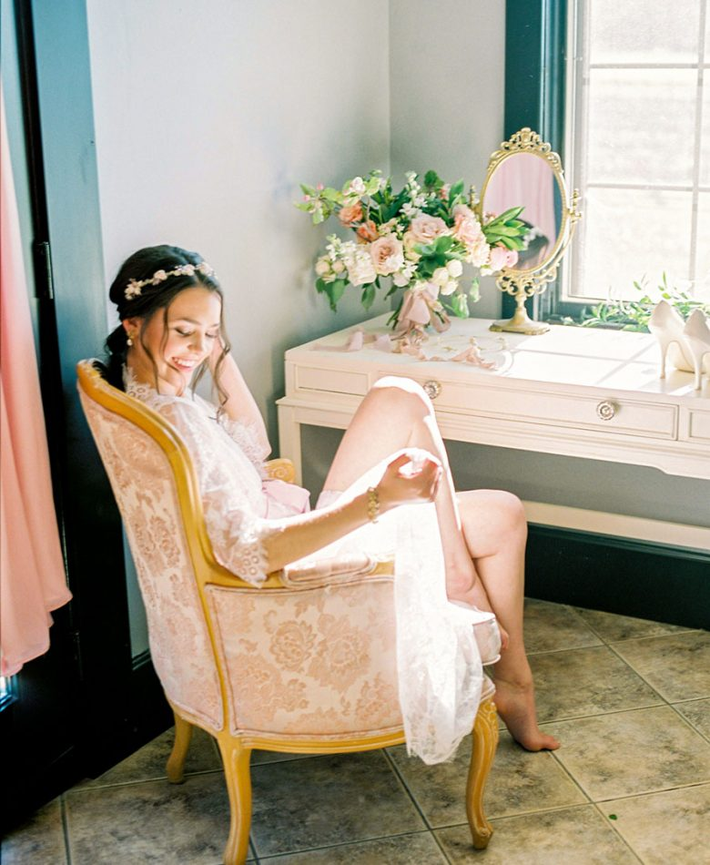 A bride in an intimate bridal lounge
