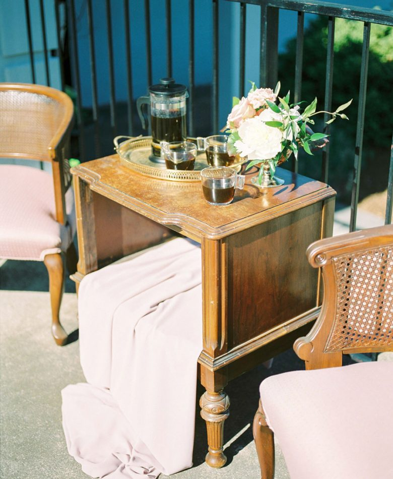 Intimate brunch wedding outdoors lounge and blush decor accents.