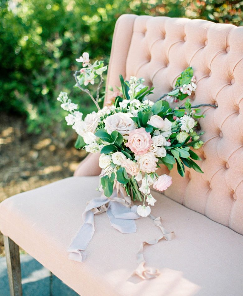 Intimate wedding peach settee with a blush bouquet
