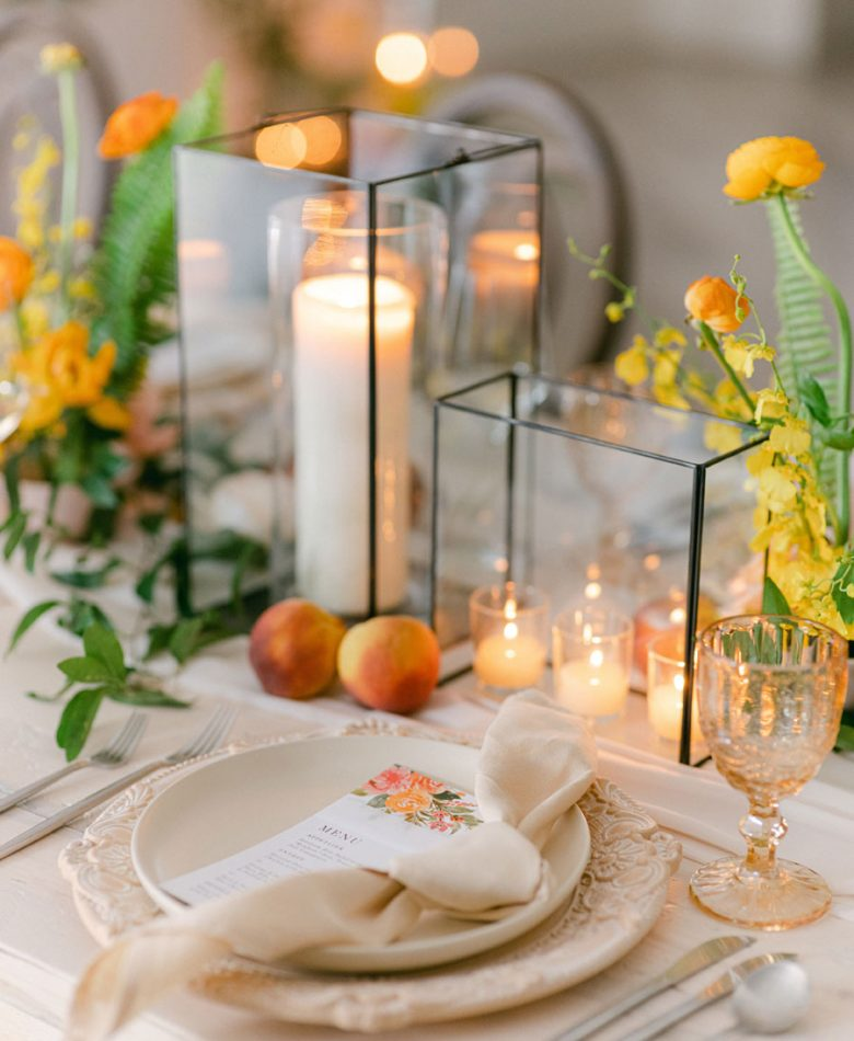 Candle centrepiece with peach accents