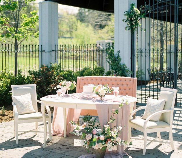Intimate brunch wedding with a table settings outdoors and blush decor accents.